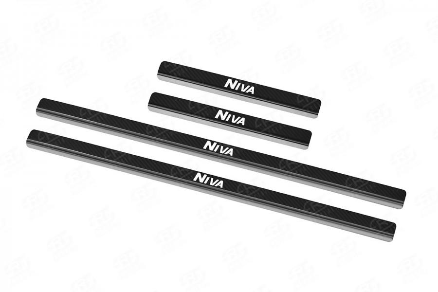 LADA NIVA TRAVEL 2021- Накладки на пороги  (нерж., карбон, надпись) LANIVT21-06